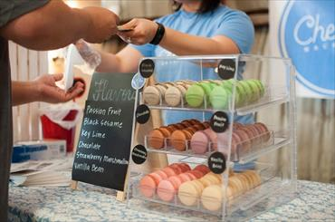 Image of customer buying baked goods at the counter of a bakery